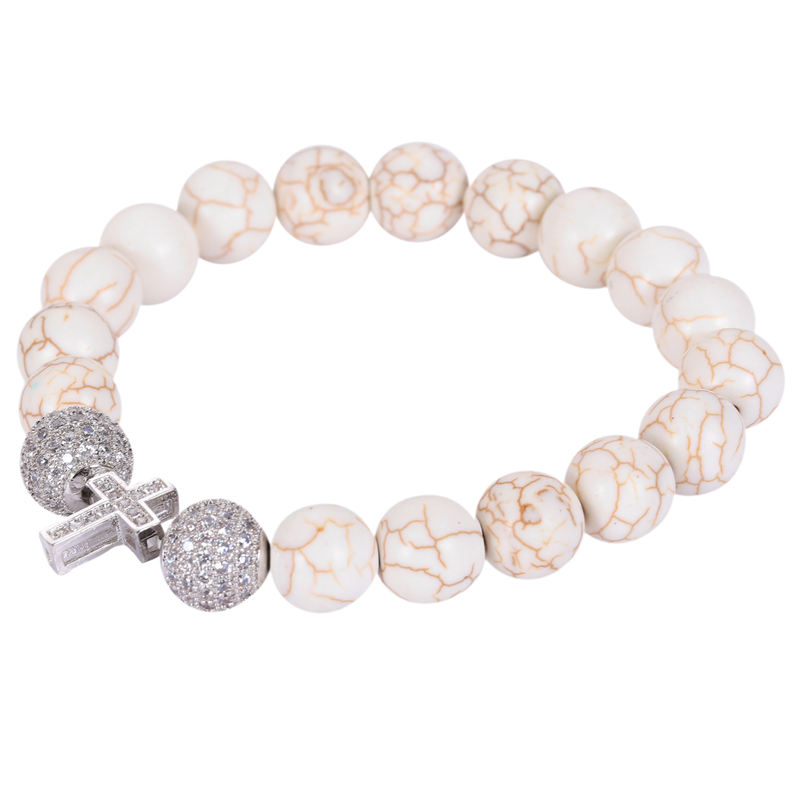 dehnbares seitliches Kreuz Armband mit weissen tuerkisfarbenen Perlen & Kri C5G7