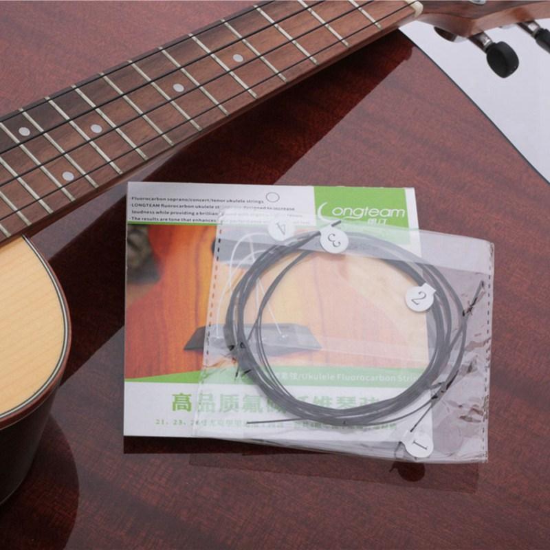 Longteam-Ukulele-carbonio-Strings-fluorocarburi-fibra-Corde-per-21-23-26-po-U5U7 miniatura 4