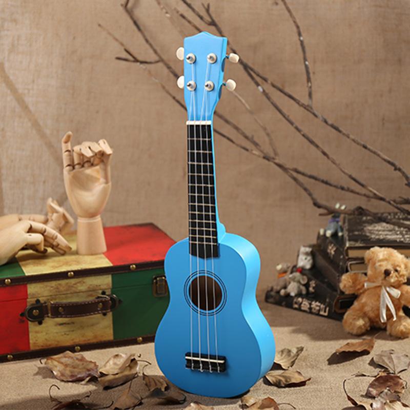 21-pollici-Soprano-Ukulele-4-stringhe-hawaiano-Chitarra-Uke-Stringa-Sce-O4R2 miniatura 34