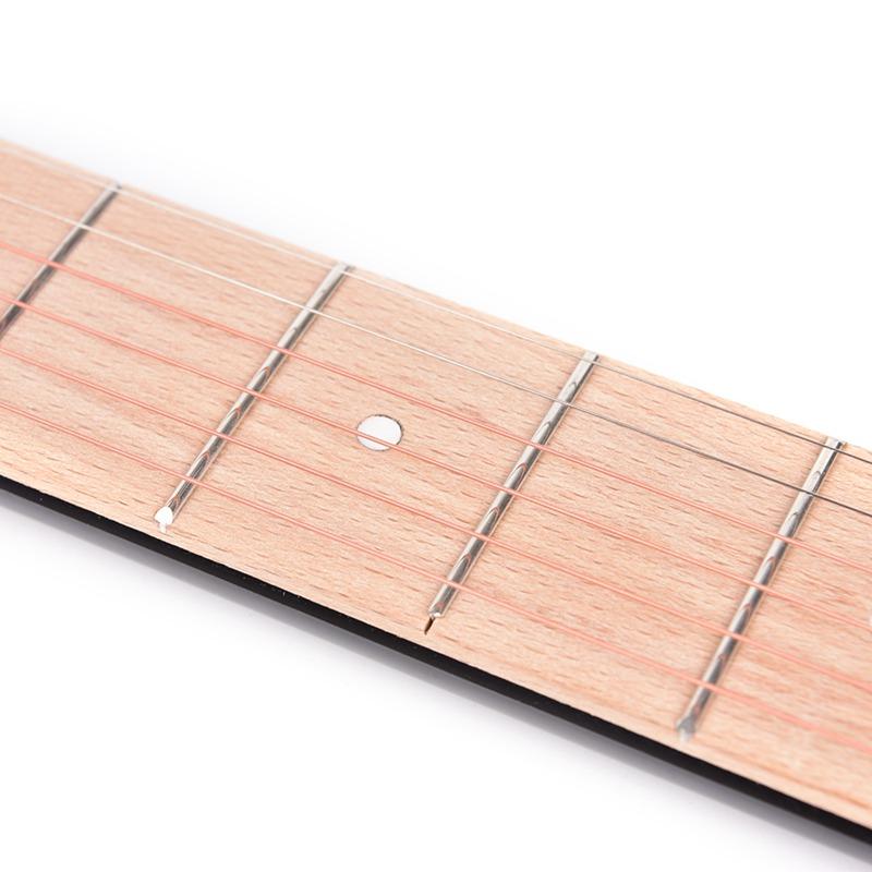 1-Stueck-Mini-Tragbare-Gitarre-Taschengitarre-Trainieren-6-Saiten-GitarrentrP5V8