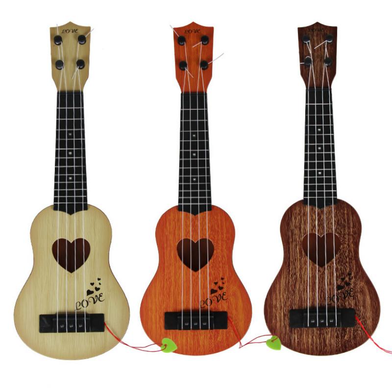 Juguete-Guitarra-De-EducacioN-Infantil-Temprano-Instrumento-Guitarra-Ukelel-J3D2 miniatura 4