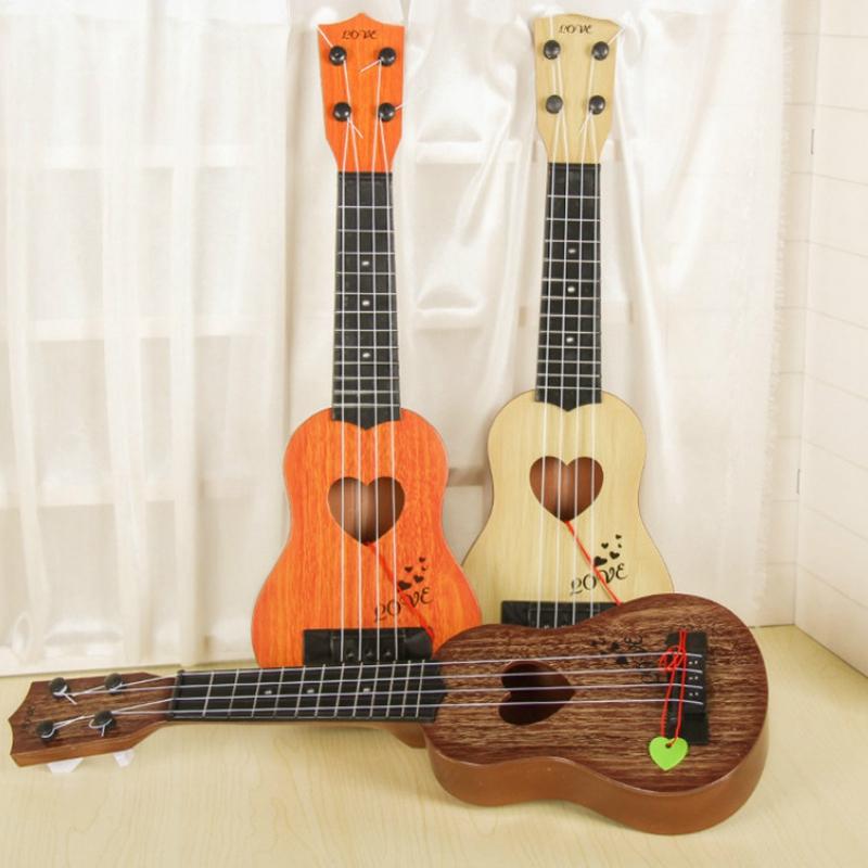 Juguete-Guitarra-De-EducacioN-Infantil-Temprano-Instrumento-Guitarra-Ukelel-J3D2 miniatura 29